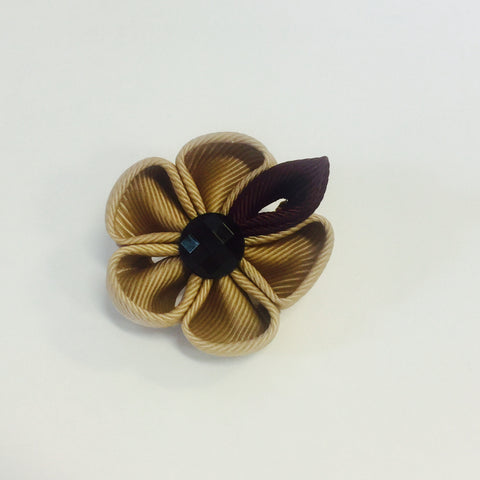 """The Gesture"" Tan Floral Lapel"