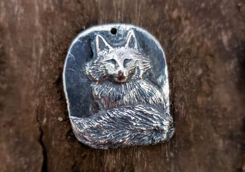 Sculpted silver sitting fox bas relief pendant jewelry by Renee fukumoto