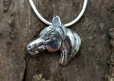 Sculpted silver horse head with heavy forelock animal jewelry pendant