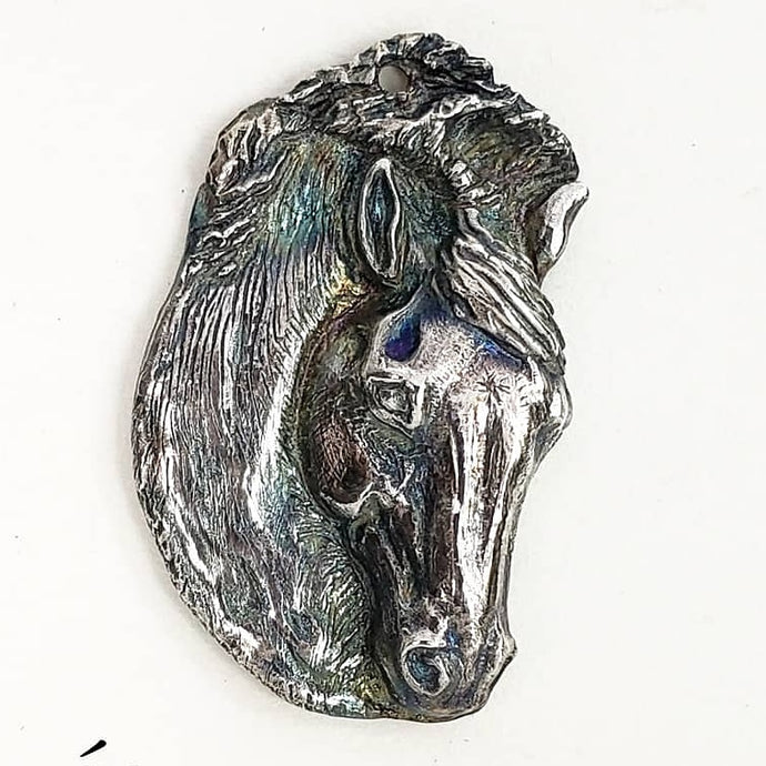Sculpted fine silver horse head pendant by Renee Forth-Fukumoto. Draft horse jewelry