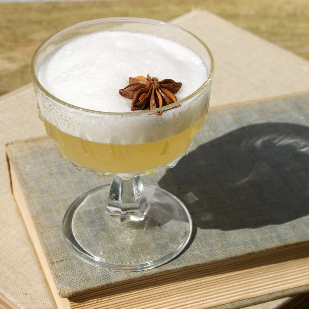 Margo Tenenbaum's Guilty Pleasure NA whiskey sour with white foam in coupe.