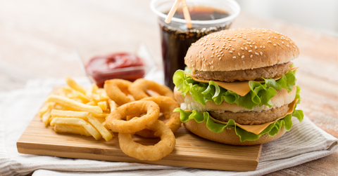 fast food meal with hamburger, fries and soft drink