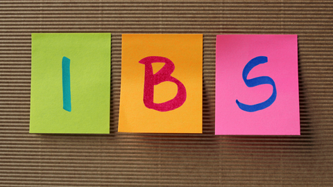 Post It notes with one letter on each spelling IBS