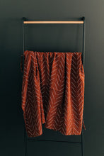 Load image into Gallery viewer, Rust Mudcloth Muslin Swaddle Blanket