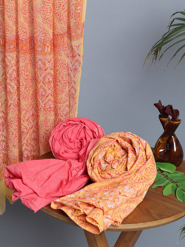 Peach And Yellow Cotton Printed Dress Material