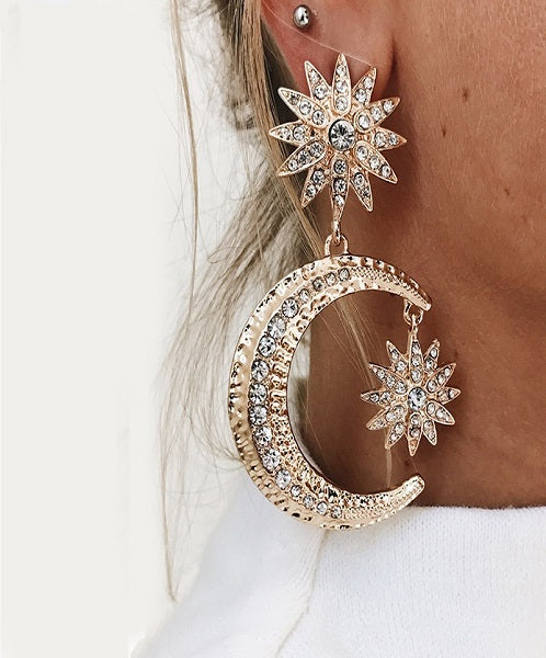 Luna Drop Earrings comes with a moon and sun shapes covered with rhinestones. It will give glitz and glamour to any outfit.