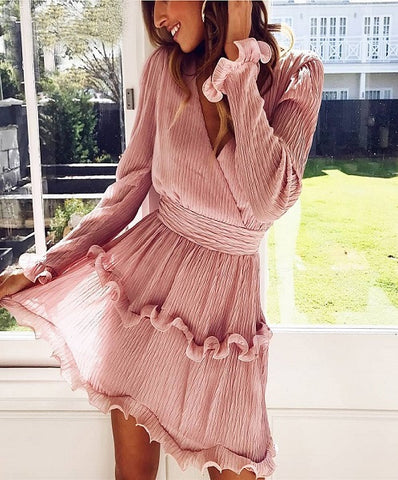 Shirley Pleated Dress is a cute ruffled mini dress with long sleeves