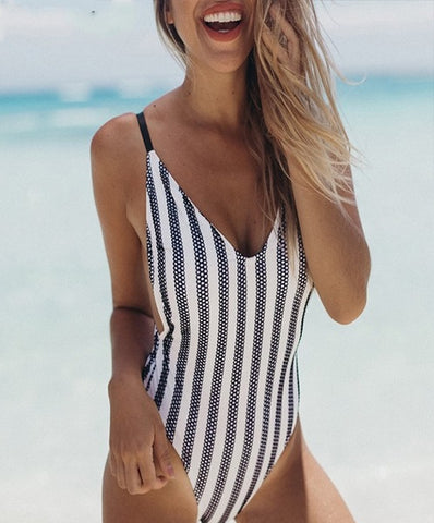 Carlie Swimsuit is a stylish bathing suit with stripe details.
