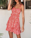 Kia Dress is a flowy and stylish mini dress with overall ruffle details.