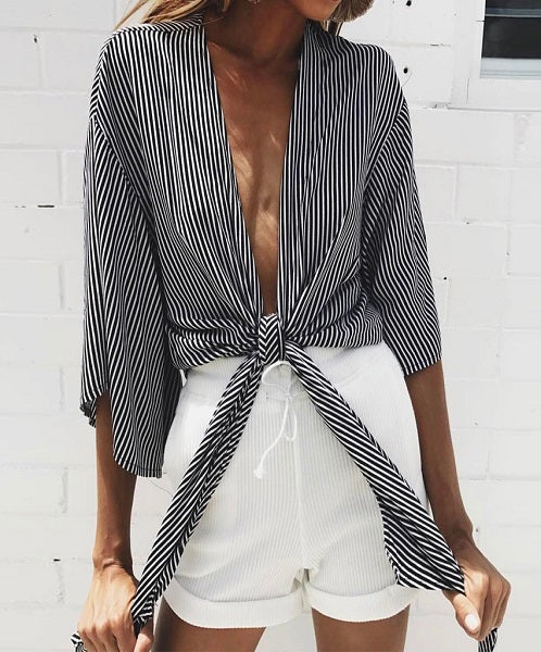 Perine Loose Kimono is a sexy striped cardigan perfect for summer.