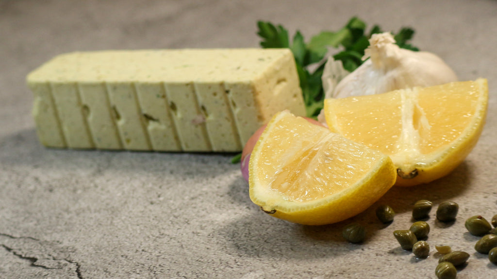 Lemon Caper Butter, Shallot, Parsley and garlic on slate background
