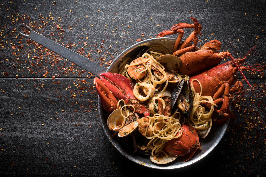 World Famous Lobster Fra Diavolo From The Daily Catch on Slate Background served in the pan