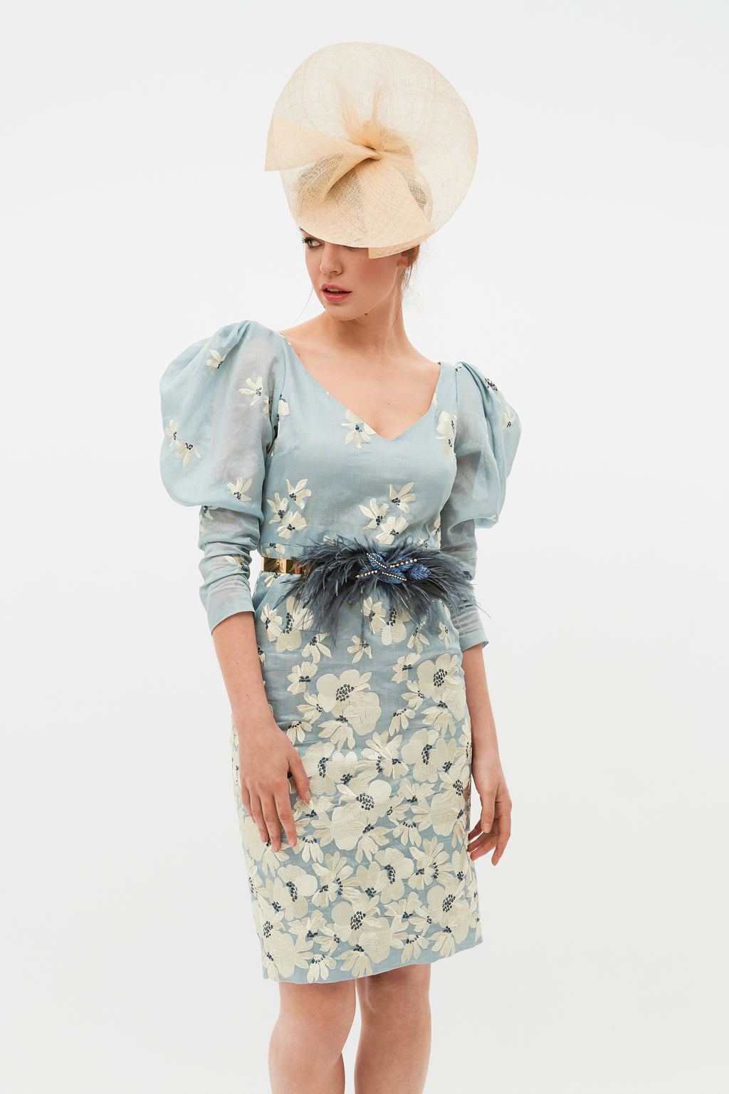 Short sky blue guest dress made of tencel and embroidered linen. Long sleeves, puffed dress and V-neckline.