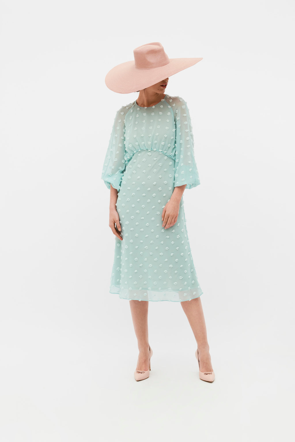 Ceremony dress made of chiffon with large frayed polka dots. Dress with long sleeves with elastic band