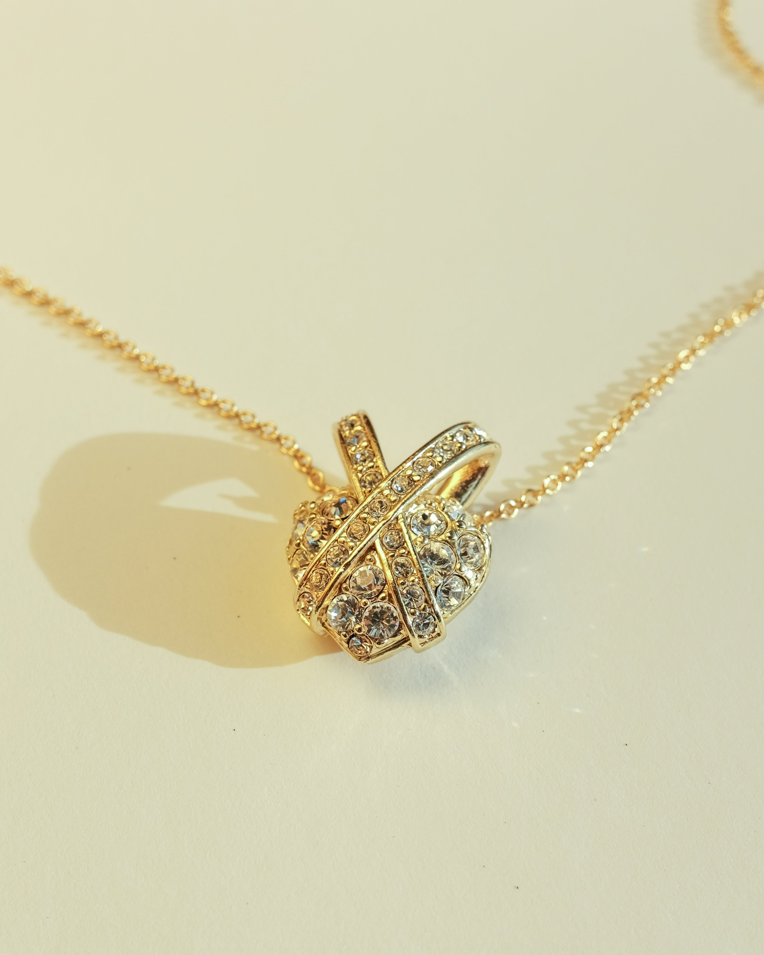 VINTAGE NOLAN MILLER HEART NECKLACE WITH CLEAR AUSTRIAN CRYSTALS