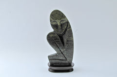 abstract crouching person carving