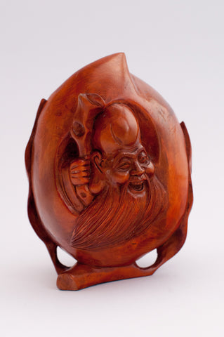carved wood apple sized wiseman holding staff