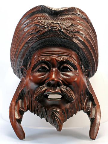 carved wood indian male face