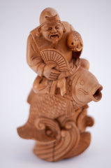 carved wood fisherman riding and holding fish 10