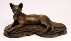 Bronze cat figurine, laying long, ears pricked alert