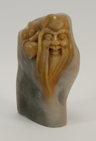 cheeky small carved soapstone wiseman hugging peach 020