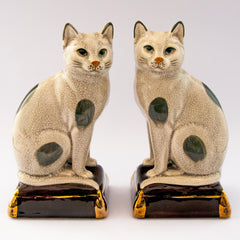 pair cats sitting gold pillow