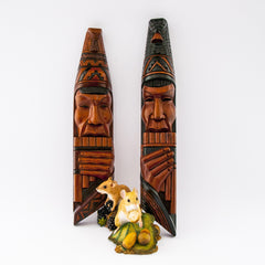 pair wood tribal carving faces playing panpipes
