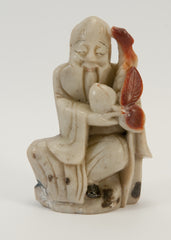 small carved soapstone wiseman holding peach staff 030