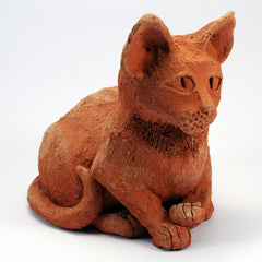 Terracotta textured clay cat ornament, contently sitting pose.