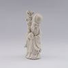 white porcelain figurine blanc de chine wiseman staff peach
