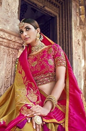 Mustard and rani pink banarasi silk wedding saree