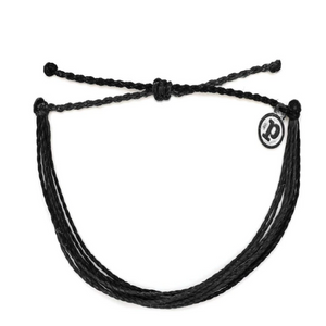 "Pura Vida Black Solid Bracelet It's the bracelet that started it all. Each one is handmade, waterproof and totally unique—in fact, the more you wear it, the cooler it looks. Grab yours today to feel the Pura Vida vibes. - 100% Waterproof- Wax-Coated- Iron-Coated Copper ""P"" Charm- Adjustable from 2-5 Inches in Diameter"