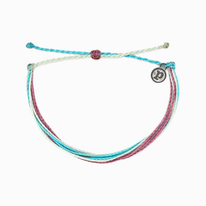 "Pura Vida Bright Original in Good Vibes It's the bracelet that started it all. Each one is handmade, waterproof and totally unique—in fact, the more you wear it, the cooler it looks. Grab yours today to feel the Pura Vida vibes. 100% Waterproof Wax-Coated Iron-Coated Copper ""P"" Charm Adjustable from 2-5 Inches in Diameter"
