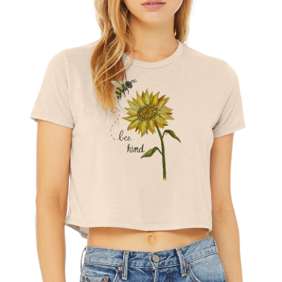 coprred. toptan color shirt with painting of bee and sunflower. it says Bee Kind