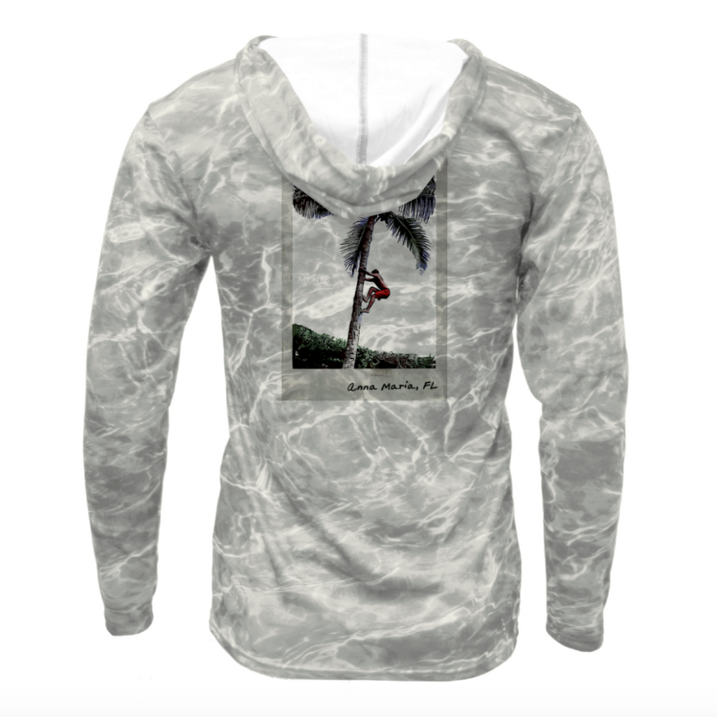 dry fit shirt with upf in a water grey pattern with photo of boy climbing palm tree on the back