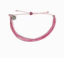 "Load image into Gallery viewer, It's the bracelet that started it all. Each one is handmade, waterproof and totally unique—in fact, the more you wear it, the cooler it looks. Grab yours today to feel the Pura Vida vibes. 100% Waterproof Wax-Coated Iron-Coated Copper ""P"" Charm Adjustable from 2-5 Inches in Diameter"