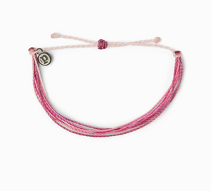 "It's the bracelet that started it all. Each one is handmade, waterproof and totally unique—in fact, the more you wear it, the cooler it looks. Grab yours today to feel the Pura Vida vibes. 100% Waterproof Wax-Coated Iron-Coated Copper ""P"" Charm Adjustable from 2-5 Inches in Diameter"