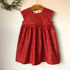 Red and gold sparkle dress