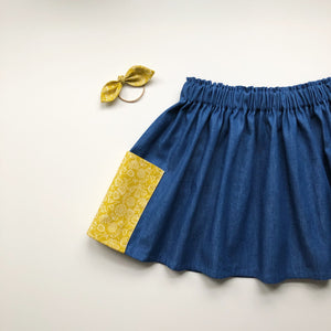 Mustard print girls twirly skirt with large pockets 8-9 years