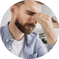 Man with headache holding nose bridge
