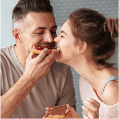 Couple sharing a waffle