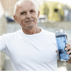 Man smiling with water bottle