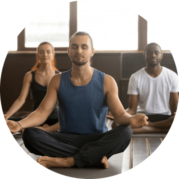 Three people mediating/doing yoga