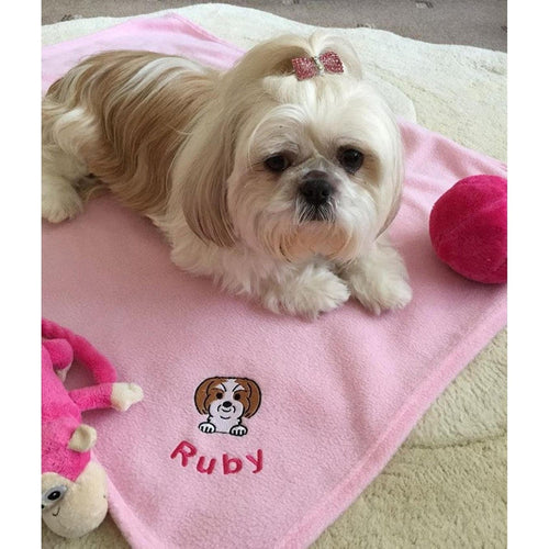 Personalised pet blankets for dogs. Image of your dog and the name of your dog embroidered on the fleece blanket