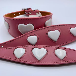 leather padded, suede backed whippet greyhound collar in pink leather with embossed white heart design