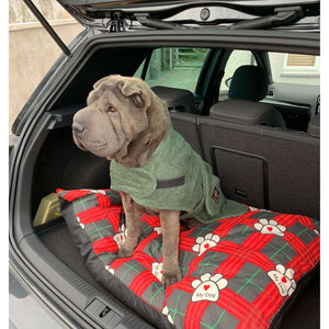 Straight from the beach and into the boot. The dog towelling dry robe is perfect for any wet dog