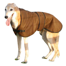 Load image into Gallery viewer, Ted the greyhound wearing our brown coloured wax lurcher coat in the countryside