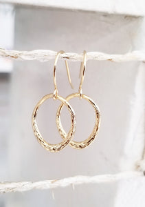 Gold oval dangle earring