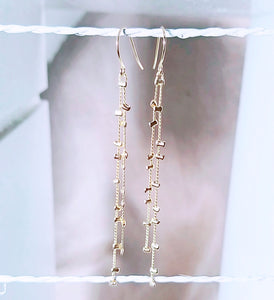 Two low gold mini bead dangle earring
