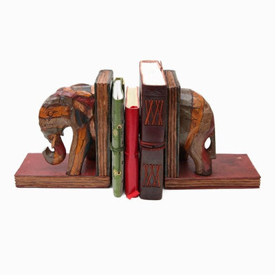 Carved wooden bookends in the shape of an elephant